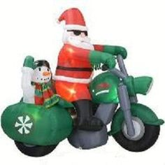 """Gemmy - Santa Claus on Motorcycle with Snowman in Sidecar - """" North Pole Rider """" - 7 ' Foot / Feet Long - Christmas Airblown Inflatable Gemmy,http://www.amazon.com/dp/B001HDLDLO/ref=cm_sw_r_pi_dp_jnaNsb13WH00BYYB"""