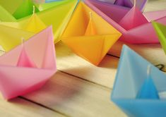 floating Origami Boat Candles by designer Roman Ficek