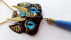 Hello world!  Meet my new custom pendantq,  Egyptian Black Sphinx with blue eyes and matching decor  asked to be with pupils,  I really like how it turned out, makes me wanna experimnet even more with different eyes, decorations and colors  and tassels #blackcat #catpendant #catnecklace #sphinxcat #catlovers #egyptianjewelry