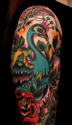 love love love this one!!!  vibrant peacock tattoo