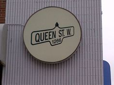 a sign in Parkdale - west queen west Downtown Toronto, Sign, Queen, Show Queen
