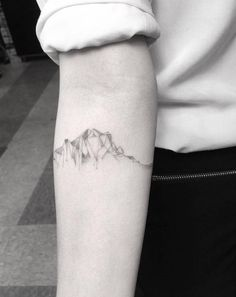 Fine line style cubist mountain range on the right inner forearm.