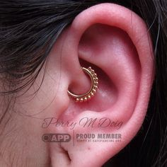 """Corrina paid us a visit yesterday and let me perform this daith piercing on her.  It sports a lovely, 18k gold """"Vaughn"""" ring by @anatometalinc.  #piercingsbyperry #goldslinger #appmember #rosegoldsf #safepiercing #sanfrancisco #fashion #finejewelry #classyclients #gold #goldforeverybody  (at Rose Gold's Tattoo & Piercing)"""