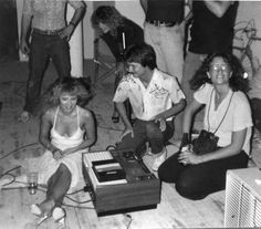 a Gordon Perry photo of Stevie, who has a deep tan, is wearing a sundress and high heels - not boots - at a private function; her friend Robin Snyder Anderson can be seen bending over in the background, amongst other friends and production crew