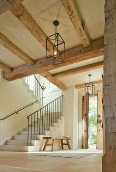 French farmhouse interior design inspiration flows from this magnificent architecturally stunning entry with natural rustic antique beams double doors stone steps and delicate wrought iron railing. The palette is quiet and the mood is naturally elegant. Farmhouse Interior, French Farmhouse, Rustic Farmhouse, Farmhouse Ideas, Farmhouse Style, Farmhouse Design, Farmhouse Stairs, Modern Interior, Country Interior