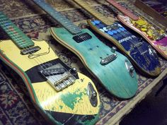 Skate Guitars - Body and neck are made out of old skateboard decks and fashioned into fully functioning, live-performance quality electric guitars.