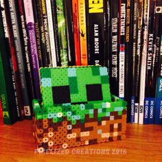 Minecraft themed coasters and dirt block coaster holder - $25 via Pixelized Creations https://www.etsy.com/ca/listing/263882003/minecraft-themed-fused-bead-coaster-set