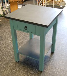 """Chic+vintage+side+table+refinished+in+rich+teal+and+black+chalk+paint.+Features+two+tiers+and+a+top+drawer+for+ample+storage.+Would+make+a+great+nightstand+for+a+bedroom!+Solid+and+in+excellent+condition.    Measures+28.25""""+high+x+21""""+x+21""""    *NOTE:+Only+local+pickup+or+local+delivery+is+availab..."""