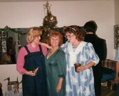 Christmas 1985 Mom standing between two pregos