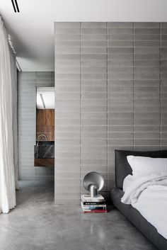 A pair of bedrooms accommodated in the existing house were modernised by replacing their decaying structure with spotted-gum floorboards, and introducing new hearths in place of the neglected fireplaces.