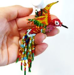 Exquisite life-size brilliantly beaded hummmingbird