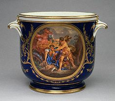 In 1783 Louis XVI commissioned a dinner service for the palace of Versailles, including this wine bottle cooler. By the time the king was executed in 1793, less than half of the proposed 442 pieces had been completed by the Sèvres Porcelain Manufactory