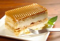 """Milhoja. Is a very creative dessert. At first glance, it appears to be a regular slice of cake. However, given a closer look it becomes clear it is not your ordinary """"slice of cake."""" Milhoja is made from many stacked layers of puff pastry—hence the name """"mil hojas,"""" which translates to """"a thousand leaves."""" In between the layers of puff pastry, you will find arequipe, a creamy mix of condensed milk, sugar, and vanilla, or sometimes white chocolate."""