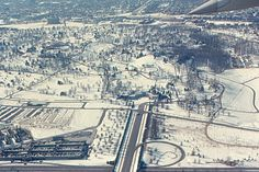Arlington Cemetery from Air  Arlington National Cemetery from the air, on a winter day in 1970. The road in the center leads directly off the Arlington Memorial Bridge over the Potomac River. The Custis-Lee mansion is above the center of the photo, directly in line with the bridge entrance.   Jeffereson Davis Highway, Route 110, crosses the photo in front of the cemetery entrance. It is a continuation of Wilson Boulevard in Rosslyn, somewhere to the right of this photo. Arlington Boulevard…