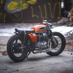 CB 750 four cafe racer with nice stubby exhaust