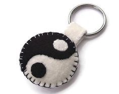 A plush ladybug keychain. This handmade felt key ring is made to look like a friendly ladybug. Bright red and dark black wool blend felt are carefully cut and sewn into the shape of a colorful bug, then lightly stuffed with poly fill to give it some soft plushness. A tag of coordinating felt attaches it to a 1 1/4 in (3 cm) split ring. This cute lady bug is ready to go along with you as a keychain, zipper pull, or fun decoration!    1 3/4 in wide x 2 1/2 long (4.5 x 6 cm). Made in a smoke…