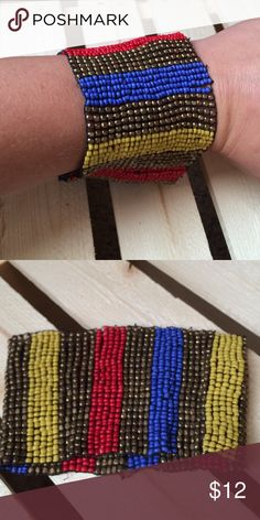 Striped Beaded Bangle Thick 6cm wide Yellow, Red, Blue and Bronze striped elastic bangle!!  Adorable just too big for my tiny wrist!!!  The length is 10cm Jewelry Bracelets