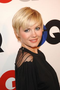 soft and feminine pixie? Either way a very pretty short hairdo with side-swept fringe - Elisha Cuthbert