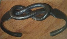 Forged knot work bracelet.