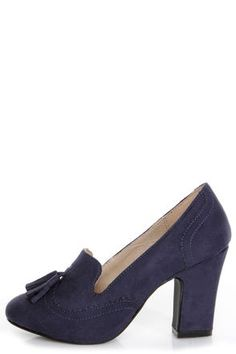 Check it out from Lulus.com! Give your smoking slippers a nice little boost from the Chelsea Crew Luba Navy Blue Smoking Loafer Heels! Faux suede loafers have brogue-style serrations along the heel cup and sweetheart-cut round toe, where two tassels add a preppy embellishment. 3.5