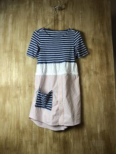 An adorable T-shirt dress/tunic, up cycled cotton jersey knit. Casual and comfortable wear all day, so cute with leggings or jeans. Fun and funky, lots of funky stitching and usable pocket in front. Clothes to live in... Approximate Measurements Bust area - 18 lying flat so