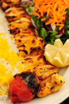 Boneless Chicken Kabob : Succulent pieces of chicken tender marinated in lemon juice and saffron, skewered and broiled over open fire to perfection, served with basmati rice and BBQ tomato. All dishes are served with steamed basmati rice.   #Chicken #Kabob #Food forked.com