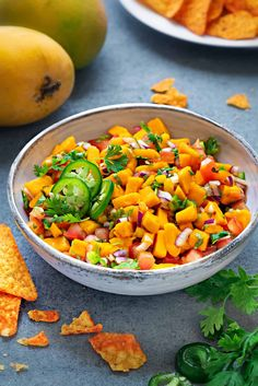 This simple recipe for homemade Mango Salsa is currently playing on repeat at my house. It's sweet, spicy, and irresistibly fresh! Once you try making this easy condiment, I have a feeling you'll be hooked all summer long.