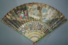 Fan circa 1740. The ivory guards are colored in green and red and applied with mother of pearl.