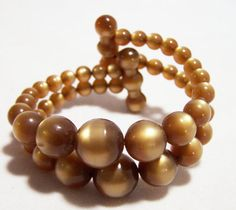 Lucite Moonglow Bead Coil Cuff Bracelet Brown by GretelsTreasures