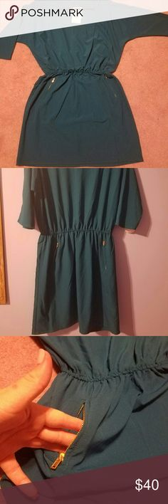 """Teal Tunic with Zippered Pockets NWT, beautiful flawless tunic purchased from JustFab and, unfortunately, was way too big for my liking. It is an Adult Samsung, but would fit M or L way better. It is a nice """"silky"""" material, has 3/4 length sleeves, has 2 deep zippered pockets on each side, and also a thin elastic band that hits at the waistline. It would be beautiful paired with leggings and boots! If you have any questions or would like to see more pics, just ask ☺ JustFab Tops Tunics"""