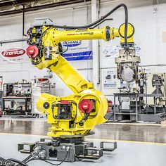 The FANUC robot is a heavy payload robot with great versatility. RobotWorx offers new and reconditioned versions of the FANUC robot. Fanuc Robotics, Robotic Automation, Machine Parts, Robots, Engine, Industrial, Surface, Technology, Amazon