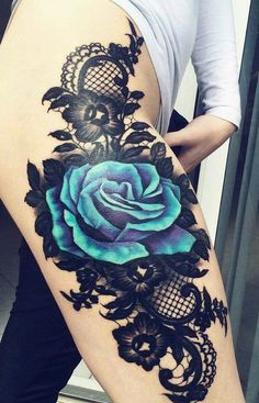 An amazing thigh piece. Blue rose and lace