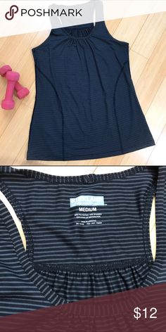 Workout exercise top, M. Kirkland signature workout top, size medium. Never worn. Racer back, no shelf bra. Bust is 17 inches and stretchy, length is 26 inches. Excellent for any type of fitness routine. kirkland Tops Tank Tops