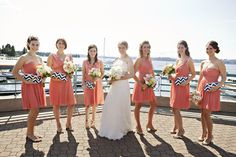 Coral bridesmaids dresses with chevron clutches | Courtney Bowlden Photography
