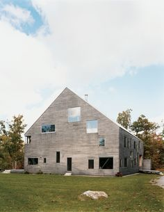 """The Pine Plains, New York, home of Elise and Arnold Goodman boasts 48 windows, the largest of which measures 8'6'' by 7'6''. As architect Preston Scott Cohen explains, the """"free facade makes it impossible to identify how many levels there are, or even to tell the difference between a door and a window."""" From without, the windows reveal dramatic glimpses of the 18th-century barn farm and new steel structure that support the house. From within, says Elise, """"Each season, each time of day…"""