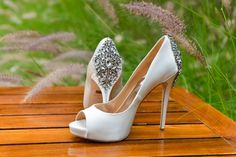 White satin heels with crystal detail. LVL Weddings & Events // Photography: Nathan Jaffan Photography// Floral: Bloomers La Jolla // Venue: Estancia La Jolla Hotel & Spa // DJ / Ceremony Musician:  Kevin Miso // Cake: Sweet Lydia's of San Diego // Photo Booth: Shutterbooth // Dress: Katie May // Shoes: Badgley Mischka