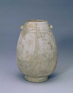 White pottery jug with ears engraving taotie pattern, Shang dynasty (c. 1600 BC–c. 1046 BC). Palace Museum, Beijing.
