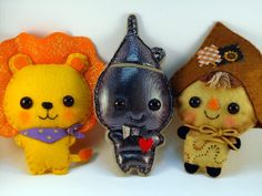 Wizard of Oz lot of three characters: Cowardly Lion, Scarecrow and Tin Man felt plush dolls in a kawaii style. $25.90, via Etsy.