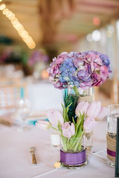 These centerpieces are beyond gorgeous... we love #hydrangeas and tulips - even more when they are together! {Riverland Studios}