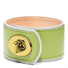 Coach Medium Leather Turnlock Cuff in either Silver and Citrine, Silver and Navy, or Silver and Chambray.  $58.00