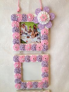 Wood Frame covered in fabric yo-yos with 3 openings
