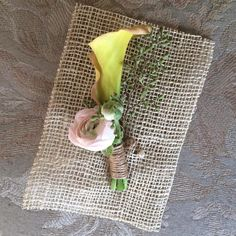 Groom boutonnière with calla lily, ranunculus, and eucalyptus seeds