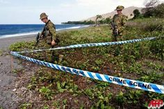 """""""LIQUICA, EAST TIMOR, 19-OCT-1999: Australian soldiers walk around a newly discovered mass grave on the beach at Liquica, 50km west of Dili October 19 1999. Authorities will attempt to exhume at least 20 bodies which have been located in three grave sites in and around the town of Liquica. [Photo by Rob Elliott, AFP]"""""""