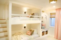 """Formerly the guest bedroom, Julia Marcum wanted to transform it into a bedroom for both of her daughters. To maximize the space, she opted for built-in bunk beds and slim stairs instead of a ladder — and the girls loved it.""""It was emotional seeing their faces see their room for the first time,"""" she says. See more at Chris Loves Julia »"""