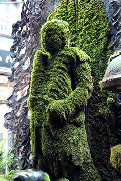 moss covered Buddha statue in Osaka