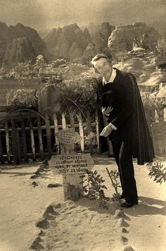 Sinister Seymour (Larry Vincent) paying his respects at Knott's Berry Farm's Boot hill, 1973, at Knott's first Halloween Haunt.