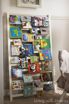 Repurpose a crib rail into a unique way to store and display books.  great idea!
