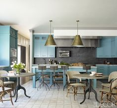 Bobby Flay's Kitchen in this month's Elle Decor is one of my favorite seen this year.  I like the blue and slate and the copper acennts. I love the hood as a sleek box