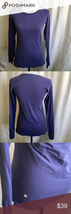 Lululemon Every Yogi Longsleeve Reversible Top Two layers of Vitasea spark released in 2012. Reverses for two different looks, heathered Gary and purple. Added Lycra fro shape retention. Flat seams. Thumbholes. Breathable. Bum covering length. Chest measures 17.5. Size estimate based on measurement. EUC. DI lululemon athletica Tops Tees - Long Sleeve
