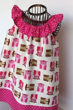 Adorable idea!This would be so cute on McKinley! I am thinking this looks like the pillowcase dress with cuteness added at the top and bottom :) Love the polkadot!